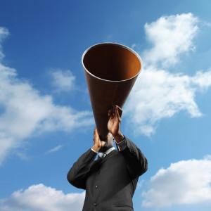 Man Holding Loudspeaker